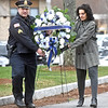 Heading up for the laying of the Memorial Wreath is Sgt. Chris Panagiotakos (a cousin) and Sally Rouses Foley (daughter of Christo Rouses). SUN/ David H. Brow