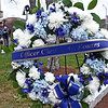 Standing by the Memorial wreath for Christos G. Rouses adorned in the colors of the Greek Flag is Massachusetts State Trooper Sean Maloney. SUN/ David H. Brow
