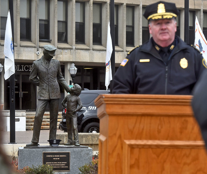 Lowell Police Superintendent Raymond Kelly Richardson, speaking at the Christos G. Rouses Memorial Ceremony, with the Memorial Statue in the background.. SUN/ David H. Brow