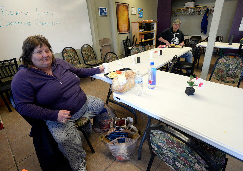 . Sandra Langley eats lunch Tuesday, March 20, 2018, at Christ\'s Church of the Rockies in downtown Loveland. Front Porch Ministry, a ministry of Christ\'s Church of the Rockies, feeds homeless people a hot lunch five days a week. The church moving out of the space at the end of March and the pastor looking for a long-term temporary location downtown to continue the feeding program. (Photo by Jenny Sparks/Loveland Reporter-Herald)