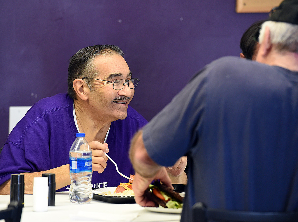 . Jesus Zubia, assistant pastor at Christ\'s Church of the Rockies and manger of the Front Porch Ministry meal program, eats lunch Tuesday, March 20, 2018, at the church in downtown Loveland. Front Porch Ministry, a ministry of Christ\'s Church of the Rockies, feeds homeless people a hot lunch five days a week. The church moving out of the space at the end of March and the pastor looking for a long-term temporary location downtown to continue the feeding program. (Photo by Jenny Sparks/Loveland Reporter-Herald)