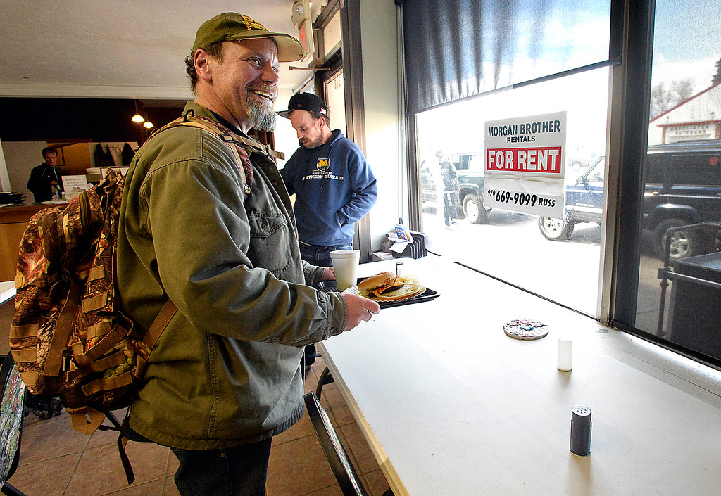 . Eddie Hammar stands with his lunch Tuesday, March 20, 2018, at Christ\'s Church of the Rockies in downtown Loveland. Front Porch Ministry, a ministry of Christ\'s Church of the Rockies, feeds homeless people a hot lunch five days a week. The church moving out of the space at the end of March and the pastor looking for a long-term temporary location downtown to continue the feeding program. (Photo by Jenny Sparks/Loveland Reporter-Herald)