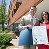 Christy Mylott Stands with State Rep Michael Kushmerek at her ceremony at the Fitchburg Housing Authority's offices on Day Street where she was honored as  the Commonwealth Heroine Class of 2021. SENTINEL & ENTERPRISE/JOHN LOVE
