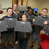 Fitchburg High School Freshmen, from left, Elise Pierce, Samual Robichaud, Erin Donelan, Fiorela Cruz-Rivera, Neville Yangsis, Ethan Chandler and Oufae Kima Tabong show off the chromebooks they use in their classes. SENTIENL & ENTERPRISE/JOHN LOVE