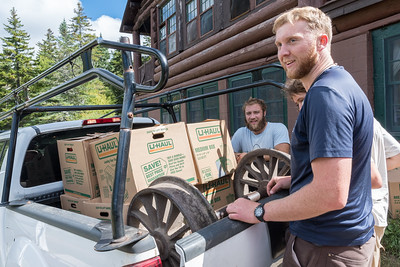 Nathanael Friday '15 leads chubbers loading the MRL railroad wheels into a pickup truck for transport to storage in '74 bunkhouse.