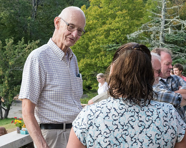 Jim Collins '84, Roger Soderberg, and Becky Todd '84, at the reception prior to the Last Supper at Moosilauke Ravine Lodge.