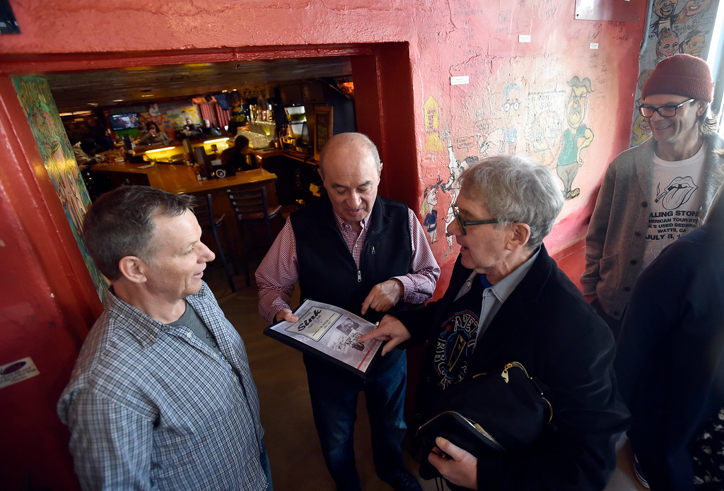 . BOULDER, CO - FEBRUARY 4, 2019: Former manager of The Sink and Colorado Music Hall of Fame Inductee Chuck Morris, at right, talks with former employee Jorge Oteo, center, and co-owner Mark Heimritz during a wall signing event on Monday at The Sink in Boulder. For more photos of the event go to dailycamera.com (Photo by Jeremy Papasso/Staff Photographer)
