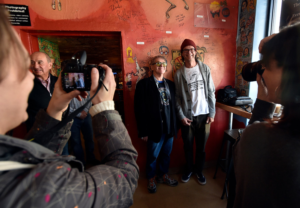 . BOULDER, CO - FEBRUARY 4, 2019: Former manager of The Sink and Colorado Music Hall of Fame Inductee Chuck Morris, left, poses for a photograph with artist Sean Bailey during a wall signing event on Monday at The Sink in Boulder. Bailey created the new Chuck Morris caricature on the wall of The Sink. For more photos of the event go to dailycamera.com (Photo by Jeremy Papasso/Staff Photographer)