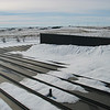 The snow drift overloaded the roof purlins, causing them to fail between the main frames.