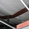 Temporary column supporting a collapsed roof purlin.