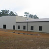 "Back side of the Fellowship hall building.  We have replaced roof and wall panels to the left of the joint between the two buildings.  They had 3.5"" of rain the day before I took this picture.  Had a meeting with a couple representatives of the church.  They are very happy with the work done so far."