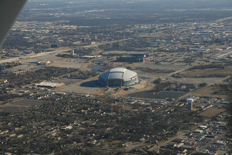 Departing Arlington Airport, I was routed Northwest, and around the North side of DFW air traffic before I could go East towards Tennessee.  Most will recognize this as the new Dallas Cowboys Stadium.  To the left of it is a super WalMart for size comparison.  Over the top of the stadium is The Ballpark in Arlington, where the Rangers play baseball.  Beyond it is 6 Flags Amusement Park, and somewhere in the trees about halfway between the roller coasters and the top of the photo, is our house.