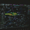 Part of my instrument panel.  GPS map showing pink line of my planned route, travling from Lexington, TN to Gainsville, FL.  Red, yellow and green blob is a thunderstorm in the way, I'm diverting right, to go around it.  Towards the upper right is a wind vector showing a 69 knot crosswind.  My current location is represented by a little airplane symbol in the center of the compass rose below the center of the screen.  We are about 10-15 miles East of Birmingham Alabama.
