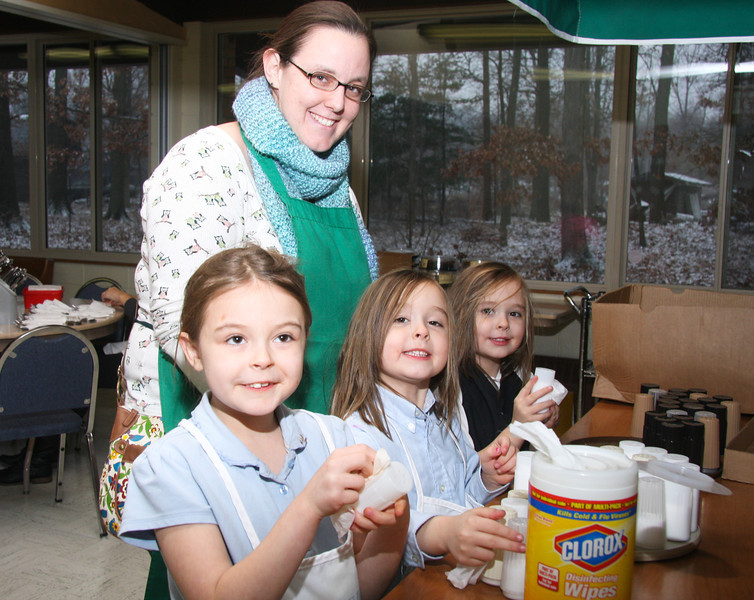Natalie, Melaine, (mother), Allison and Katelyn Williamson, cleaning the Salt and Pepper shakers.