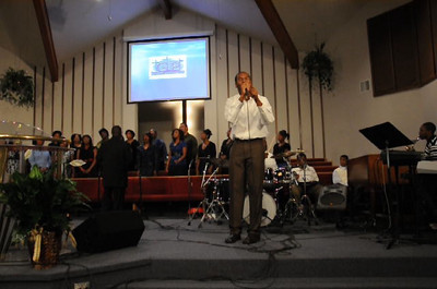 """Jeremiah and the Greater Pentecostal choir singing 'No matter what the problem""""."""