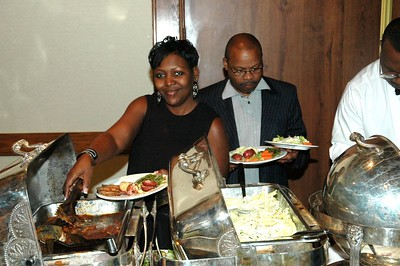 Traci enjoys the fine selection of food while Robert has his hands full.
