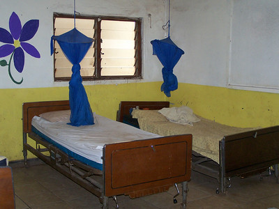 Some beds have sheets. More than likely they were provided by The Malawi Project on an earlier visit.
