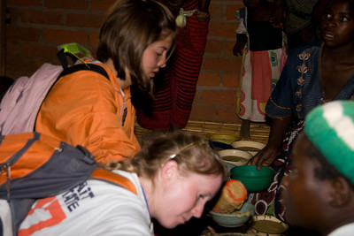 Rebecca and Leslie pour bowls with Vita-Meal porridge for the children.