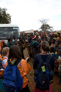 Team Auburn was greeted by hundreds at Chimbeevee Village.
