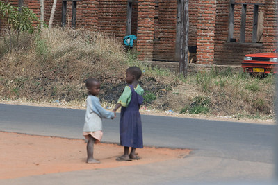 Children are everywhere and often time unattended. This culture often holds hands and watch out for one another.