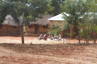Women sitting culling corn they will turn into Nsima, a from of ground up and dried maize.