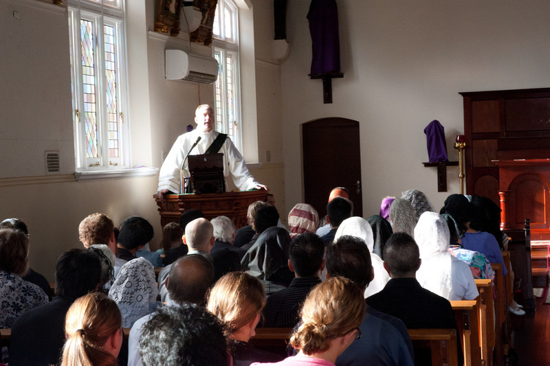 Fr Murphy giving a sermon on Good Friday