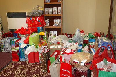 Gifts for adults in Adult Protective Services, wrapped in gift bags and ready for their party.