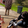 Tracy Parsons cuts angle iron for the UU Kent Green Project car while John Bores looks on.