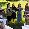 The choir rehearses for the church picnic