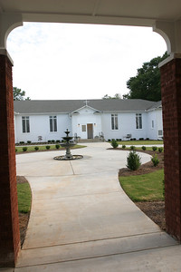 From the new church, one can look back toward the old church, which is now the parish social hall, Hedges Hall.  (Page 3, October 4, 2007 issue)