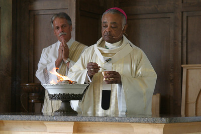 Archbishop Gregory lights the incense on the altar during the rite of dedication.  (Page 3, October 4, 2007 issue)