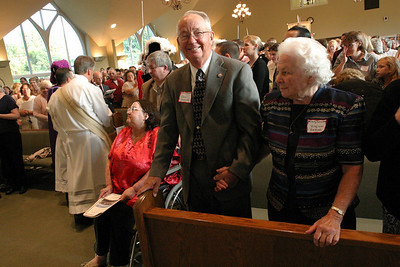 Fred and Virginia Hedges stand in the front pew as the liturgical procession exits the church. The Hedges were members of the building committee.  (Page 2, October 4, 2007 issue)