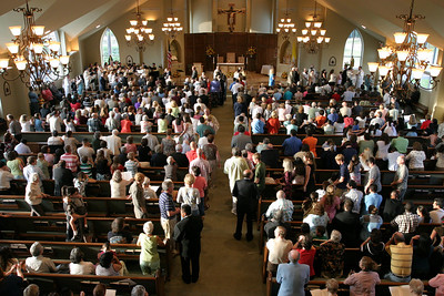 Members of the congregation receive holy Communion during the Sept. 22 Mass of dedication for St. Matthew Church, Winder.   (Page 1, October 4, 2007 issue)