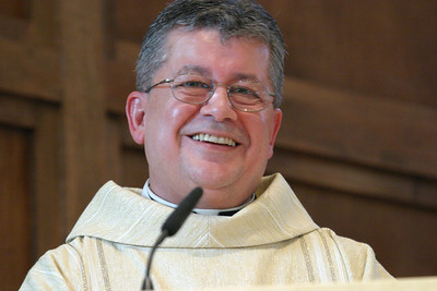 St. Matthew Church pastor Father Jaime Barona cannot contain his joy as he gives some closing remarks during the Mass of dedication.  (Page 2, October 4, 2007 issue)