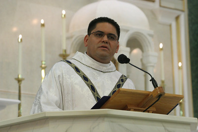 St. Patrick Church pastor Father Refugio Onate addresses the congregation during Mass.