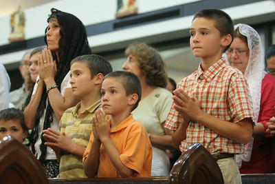 Kim Welch, wearing the black veil, and her sons (l-r) Ryan, A.J., Jeremy, and Travis stand for the closing prayer.