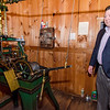 Standing Chairman Mark Knop shows off a machine used to wind the clock at First Church of Christ Unitarian in Lancaster, which is celebrating it's 200th year. The church was founded in 1816. SENTINEL & ENTERPRISE / Ashley Green