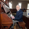 Rev. Robert Johansen plays the organ inside the First Church of Christ Unitarian in Lancaster, which was founded in 1816 and is celebrating it's 200th year. SENTINEL & ENTERPRISE / Ashley Green