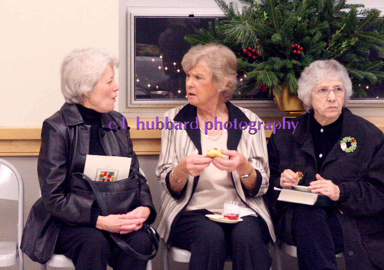 E.L. Hubbard for the Telegraph<br /> Friends sit together at the reception following the Altar dedication.