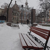 "Gates to Odessa ""Gorsad"" city park in the snow - corner of Pastera and Soviet Army St. - EPCO Presbyterian Church - park bench in snow"