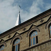 Cross back atop steeple of EPCO Reformed church of Odessa - rear view of bldg