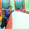 Montgomery Graham, 11, and Angel Alejandro, 11, compete at the 10th Annual Fun in the Son, held at Elm Street Community Church on Saturday afternoon.<br /> SENTINEL & ENTERPRISE / Ashley Green