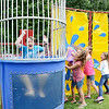 Stephen Mayo, Jr. gets dunked at the 10th Annual Fun in the Son, held at Elm Street Community Church on Saturday afternoon.<br /> SENTINEL & ENTERPRISE / Ashley Green