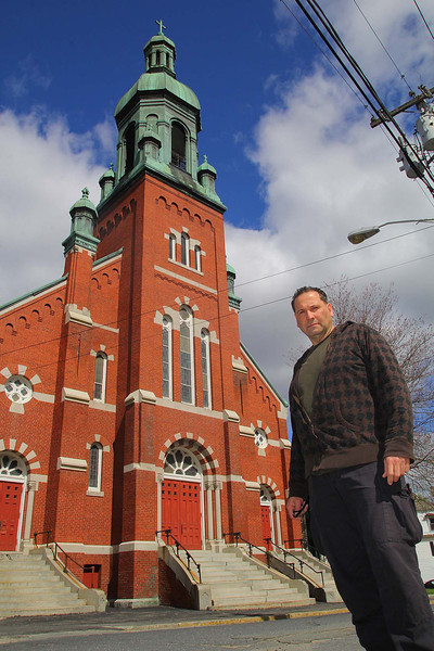 Gaetano Colomba stands out in front of Fitchburg Worship Center that will house the Kingdom Embassy that was formally Immaculate Conception Church but is having issues with the city so are not opened yet. SENTINEL & ENTERPRISE/JOHN LOVE