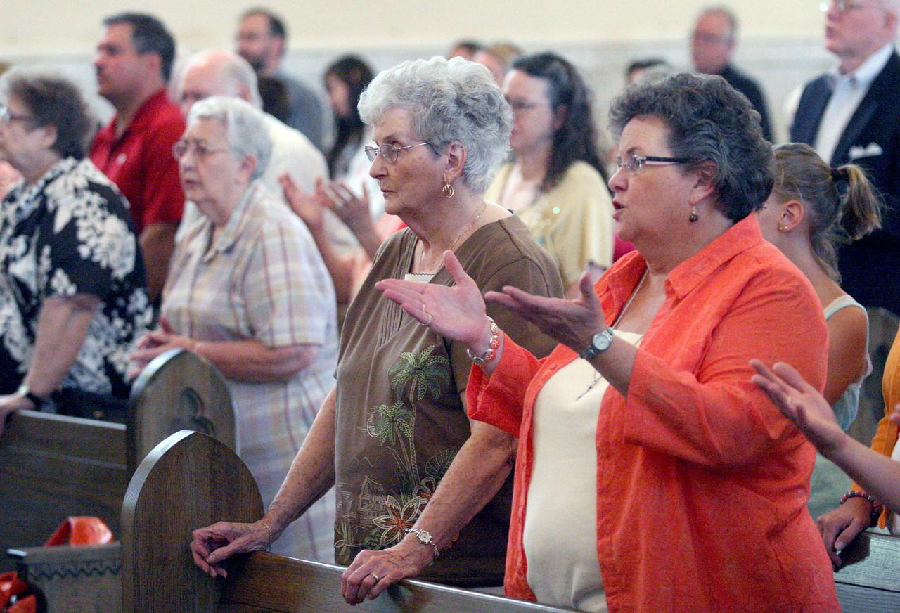 E.L. Hubbard photography<br /> Parishoners during Mass<br /> Holy Trinity 150th