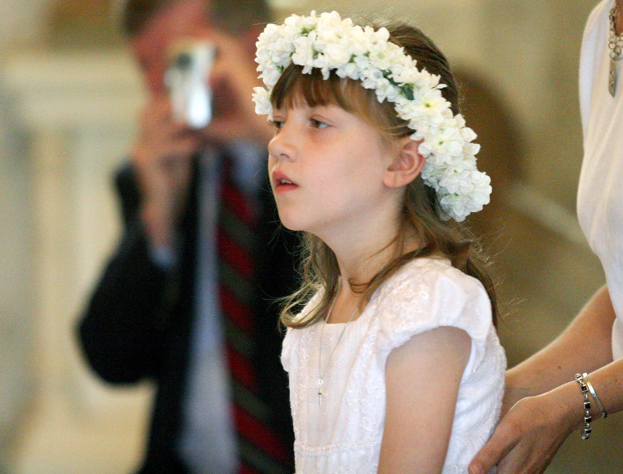 E.L. Hubbard photography<br /> Catie Goeller, First Communion, gets a little encouragement<br /> Holy Trinity 150th