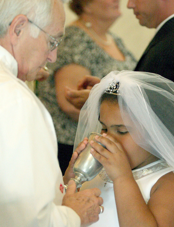 E.L. Hubbard photography<br /> Deacon George Zvonar, Haili Frowein<br /> First Communion<br /> Holy Trinity 150