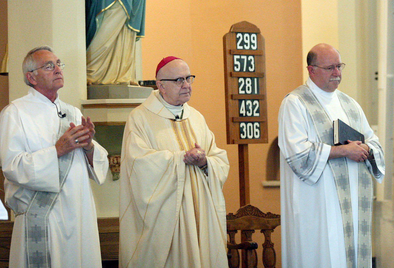E.L. Hubbard photography<br /> Deacon George Zvonar, Archbishop Pilarczyk, Fr. Rick Friebel, C.PP.S.<br /> Holy Trinity 150th