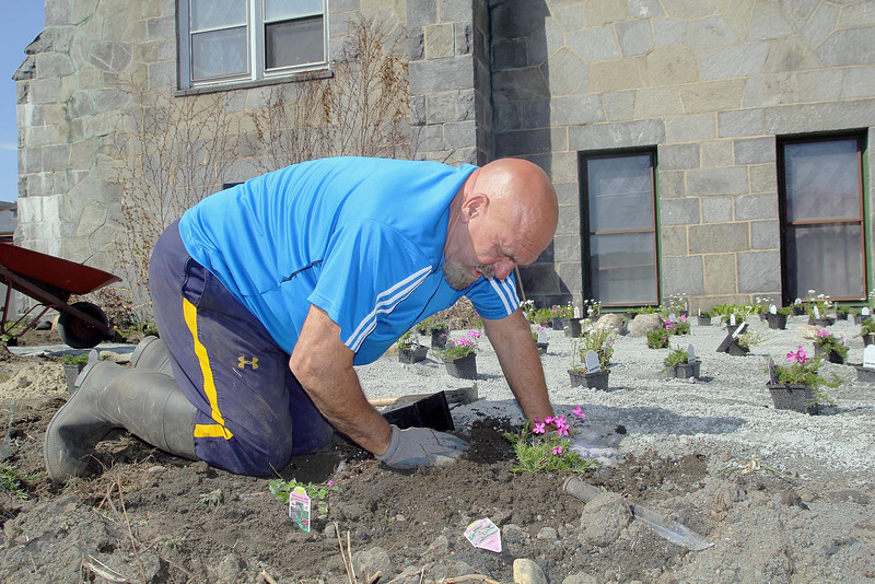 First Church Leominster Unitaran Universalist is creating a labyrinth on the West Street side of the church for all to enjoy. Ron Brown work on the area around the labyrinth on Tuesday. SENTINEL & ENTERPRISE/JOHN LOVE