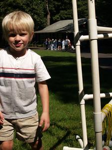 Josiah playing ladder golf